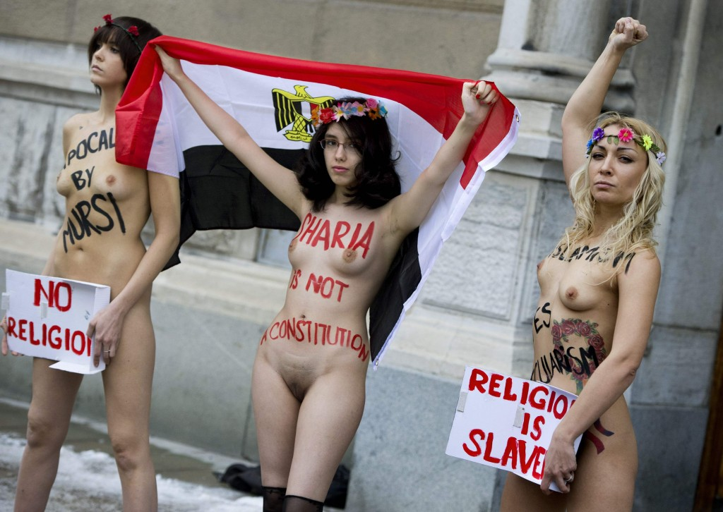 Egyptian activist Elmahdy and members of Ukrainian topless women's rights group Femen demonstrate against the Egyptian constitution outside the Egyptian embassy in Stockholm