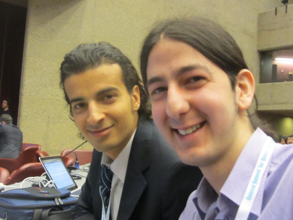 مع المدون المصري مايكل نبيل بقاعة المحاضرات-قمة جنيف-